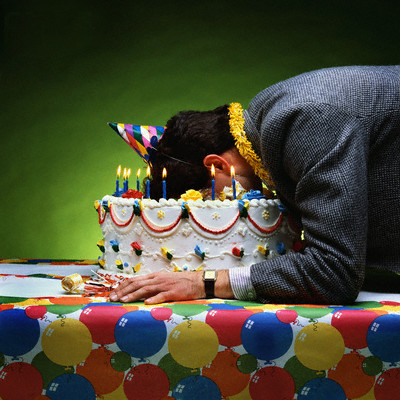 Man With Face in Birthday Cake --- Image by © Stan Fellerman/Corbis